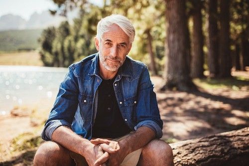 hiking man sitting outdoors after venaseal varicose vein treatment california
